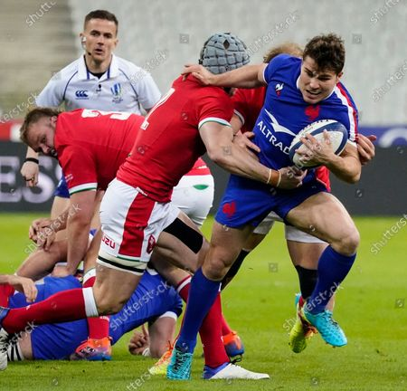 France vs Wales. France's Antoine Dupont is tackled by Jonathan Davies of Wales