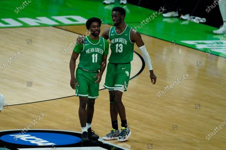 Stock Picture of North Texas's JJ Murray (11) and Thomas Bell (13) celebrate during overtime of a first-round game against Purdue in the NCAA men's college basketball tournament at Lucas Oil Stadium, in Indianapolis. North Texas defeated Purdue 78-69 in overtime