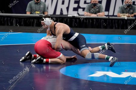 Penn State's Aaron Brooks, top, takes on North Carolina State's Trent Hidlay during their 184-pound match in the finals of the NCAA wrestling championships, in St. Louis