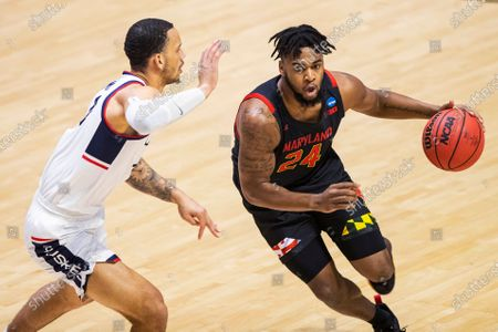 Maryland's Donta Scott (24) drives against Connecticut's Tyrese Martin during the first half of a first-round game in the NCAA men's college basketball tournament, at Mackey Arena in West Lafayette, Ind