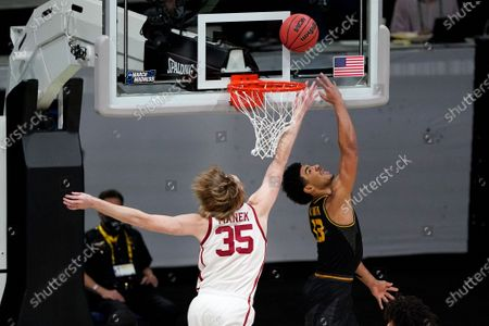 Missouri guard Mark Smith drives to the basket ahead of Oklahoma forward Brady Manek (35) during the first half of a first-round game in the NCAA men's college basketball tournament at Lucas Oil Stadium, in Indianapolis