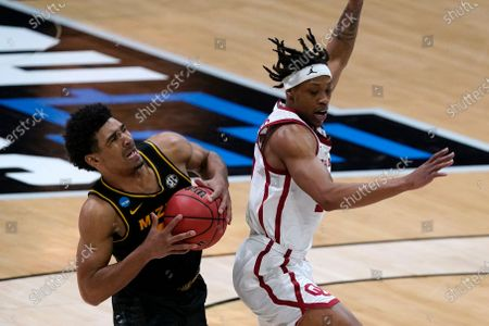Stock Picture of Missouri guard Mark Smith, left, is fouled by Oklahoma guard Alondes Williams, right, during the second half of a first-round game in the NCAA men's college basketball tournament at Lucas Oil Stadium, in Indianapolis