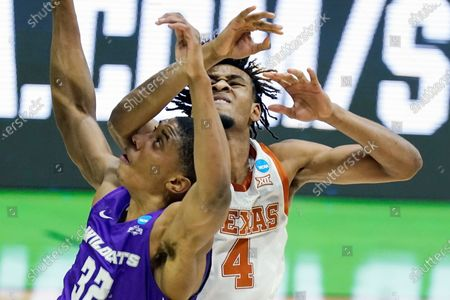 Abilene Christian's Joe Pleasant (32) and Texas' Greg Brown (4) battle for position under the basket during the first half of a college basketball game in the first round of the NCAA tournament at Lucas Oil Stadium in Indianapolis