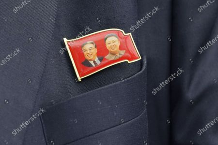Kim Yu Song, counselor at the North Korean Embassy to Malaysia, wears a pin showing North Korea's former leaders, Kim Il Sung, left, and Kim Jong Il, outside the embassy in Kuala Lumpur, . Malaysia on Friday ordered all North Korean diplomats to leave the country within 48 hours, an escalation of a diplomatic spat over Malaysia's move to extradite a North Korean suspect to the United States on money laundering charges