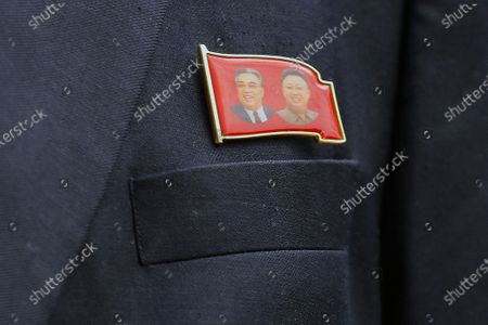 A lapel pin bearing the portrait of the late North Korean leaders Kim Il-Sung and Kim Jong-il are visible on the lapel of North Korean Embassy in Malaysia counselor Kim Yu Song before he speaks to journalist before leaving the country, outside the North Korean Embassy in Kuala Lumpur, Malaysia, 21 March 2021. According to a North Korean goverrnment report, the North Korean regime vowed to cut ties with Malaysia, after authorities in Malaysia's high court ruled that a North Korean citizen should be extradicted to the USA. The man, named Mun Chol Myong, was arrested on 13 May 2019 after US authorities requested his extradition, on money laundering charges.