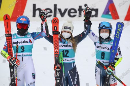 New Zealand's Alice Robinson, center, winner of an alpine ski, women's World Cup giant slalom, poses wit second placed United States' Mikaela Shiffrin, left, and third placed Slovenia's Meta Hrovat in Lenzerheide, Switzerland