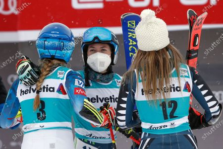 New Zealand's Alice Robinson, right, winner of an alpine ski, women's World Cup giant slalom, greets second placed United States' Mikaela Shiffrin, left, and third placed Slovenia's Meta Hrovat, center, in Lenzerheide, Switzerland