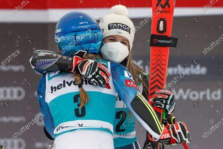 New Zealand's Alice Robinson hugs United States' Mikaela Shiffrin after winning an alpine ski, women's World Cup giant slalom, in Lenzerheide, Switzerland