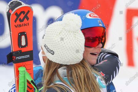 New Zealand's Alice Robinson hugs United States' Mikaela Shiffrin, right, after winning an alpine ski, women's World Cup giant slalom, in Lenzerheide, Switzerland
