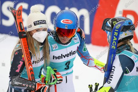 New Zealand's Alice Robinson, left, winner of an alpine ski, women's World Cup giant slalom, stands by second placed United States' Mikaela Shiffrin, center, and third placed Slovenia's Meta Hrovat in Lenzerheide, Switzerland