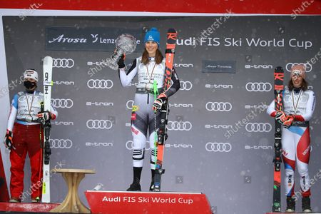 Slovakia's Petra Vlhova, center, holds the trophy of the alpine ski, women's World Cup overall title, flanked by second placed Switzerland's Lara Gut-Behrami, left, and third placed Switzerland's Michelle Gisin, in Lenzerheide, Switzerland