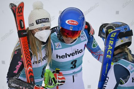 Stock Photo of (L-R) First placed New Zealand's Alice Robinson, second placed USA's Mikaela Shiffrin, and third placed Slovenia's Meta Hrovat celebrate on the podium for the Women's Giant Slalom race at the FIS Alpine Skiing World Cup finals in Lenzerheide, Switzerland, 21 March 2021.