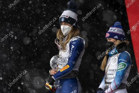 Italy's first placed Marta Bassino (L) and USA's second placed Mikaela Shiffrin (R) celebrate on the podium during the award ceremony of the Women's overall Giant Slalom competition at the FIS Alpine Skiing World Cup finals in Lenzerheide, Switzerland, 21 March 2021.