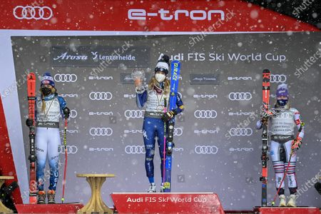 (L-R) USA's second placed Mikaela Shiffrin, Italy's first placed Marta Bassino and France's third placed Tessa Worley celebrate on the podium during the award ceremony of the Women's overall Giant Slalom competition at the FIS Alpine Skiing World Cup finals in Lenzerheide, Switzerland, 21 March 2021.