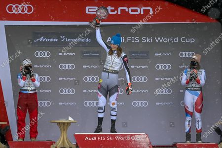 (L-R) Switzerland's second placed Lara Gut-Behrami, Slovakia's first placed Petra Vlhova and Switzerland's third placed Michelle Gisin  pose on the podium during the award ceremony of the women's overall world cup competition at the FIS Alpine Skiing World Cup finals in Lenzerheide, Switzerland, 21 March 2021.
