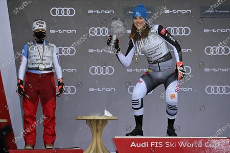 Switzerland's second placed Lara Gut-Behrami (L) and Slovakia's first placed Petra Vlhovapose on the podium during the award ceremony of the women's overall world cup competition at the FIS Alpine Skiing World Cup finals in Lenzerheide, Switzerland, 21 March 2021.