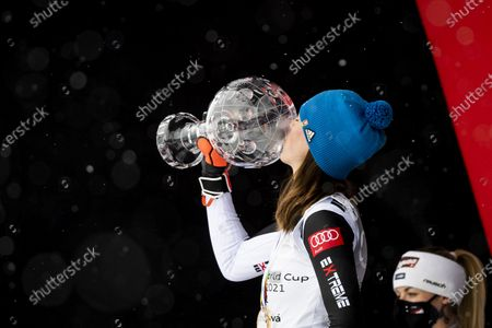 Switzerland's second placed Lara Gut-Behrami (R) looks at Slovakia's first placed Petra Vlhova during the award ceremony of the women's overall world cup competition at the FIS Alpine Skiing World Cup finals in Lenzerheide, Switzerland, 21 March 2021.