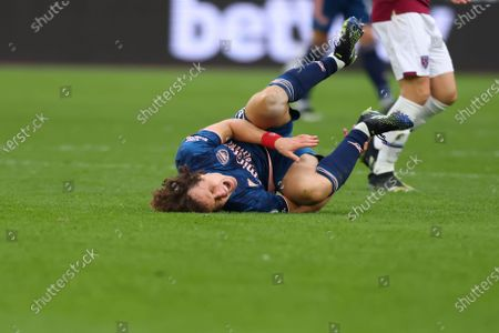 David Luiz of Arsenal goes down injured; London Stadium, London, England; English Premier League Football, West Ham United versus Arsenal.