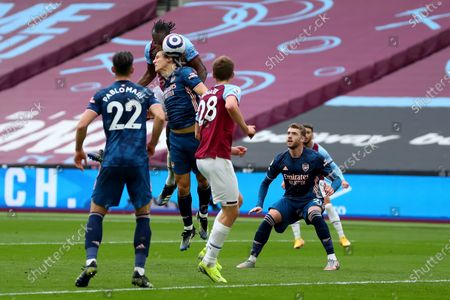 Michail Antonio of West Ham United wins a header against David Luiz of Arsenal and scores via the boot of Thomas Soucek for 3-0 in the 32nd minute; London Stadium, London, England; English Premier League Football, West Ham United versus Arsenal.