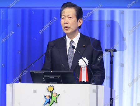 Japanese ruling coalition New Komei Party leader Natsuo Yamaguchi delivers a speech at the annual party convention in Tokyo . Suga pledged Sunday to do his utmost to prevent a resurgence of the coronavirus ahead of the Olympic torch relay and his upcoming visit to Washington