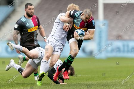 Mike Brown of Harlequins is tackled by George Barton of Gloucester during the Gallagher Premiership match between Harlequins and Gloucester Rugby at Twickenham Stoop, London on Saturday 20th March 2021.