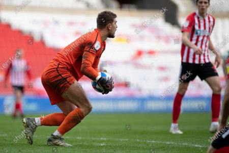 Lincoln City goalkeeper Alex Palmer easily takes the ball during the Sky Bet League 1 match between Sunderland and Lincoln City at the Stadium Of Light, Sunderland on Saturday 20th March 2021.
