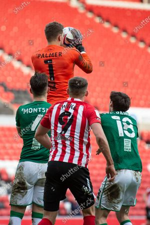 Lincoln City goalkeeper Alex Palmer catches the ball from a corner during the Sky Bet League 1 match between Sunderland and Lincoln City at the Stadium Of Light, Sunderland on Saturday 20th March 2021.