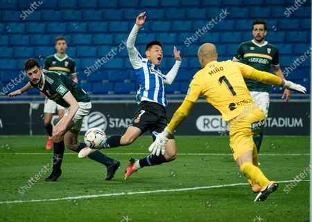 Espanyol's Wu Lei (C) competes during a Spanish second division league football match between RCD Espanyol and UD Logrones in Cornella, Spain, on March 20, 2021.