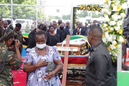 People pay tribute to former Tanzanian President John Magufuli at Uhuru stadium in Dar es Salaam, Tanzania, March 20, 2021. Tanzanian President Samia Suluhu Hassan on Saturday led her fellow citizens in paying the last respects to former President John Magufuli at the Uhuru Stadium in Dar es Salaam. Magufuli, 61, died from a heart condition on Wednesday at the Emilio Mzena Hospital in the country's commercial capital.