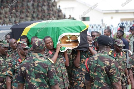 Soldiers carry the casket of former Tanzanian President John Magufuli at Uhuru stadium in Dar es Salaam, Tanzania, March 20, 2021. Tanzanian President Samia Suluhu Hassan on Saturday led her fellow citizens in paying the last respects to former President John Magufuli at the Uhuru Stadium in Dar es Salaam. Magufuli, 61, died from a heart condition on Wednesday at the Emilio Mzena Hospital in the country's commercial capital.