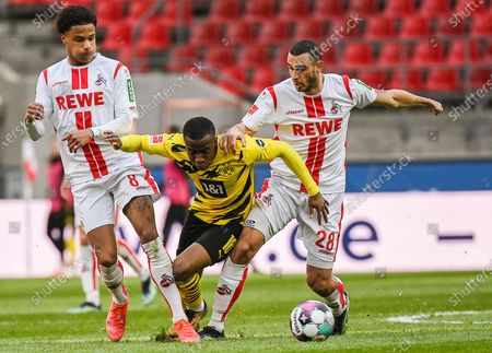 Youssoufa Moukoko (C) of Dortmund vies with Ismail Jakobs (L) and Ellyes Skhiri of Koeln during a German Bundesliga football match between FC Koeln and Borussia Dortmund in Cologne, Germany, March 20, 2021. (Photo by Ulrich Hufnagel/Xinhua) FOR EDITORIAL USE ONLY. - Ulrich Hufnagel -