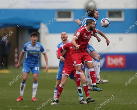 Oliver Banks of Barrow contests a header with Crawley Town's  George Francomb   during the Sky Bet League 2 match between Barrow and Crawley Town at the Holker Street, Barrow-in-Furness on Saturday 20th March 2021.