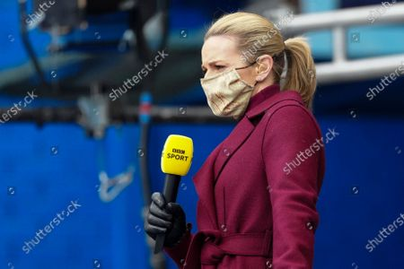 Stock Image of Gabby Logan wears a mask as she watches the game from the TV Platform