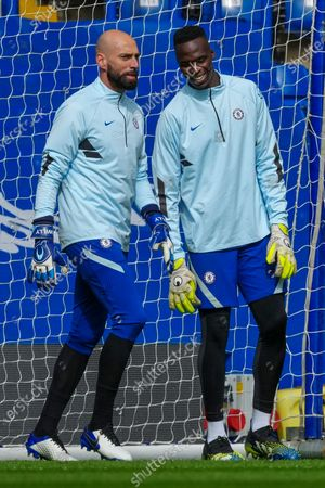 Stock Photo of Edouard Mendy of Chelsea and Willy Caballero of Chelsea warm up together before kick off