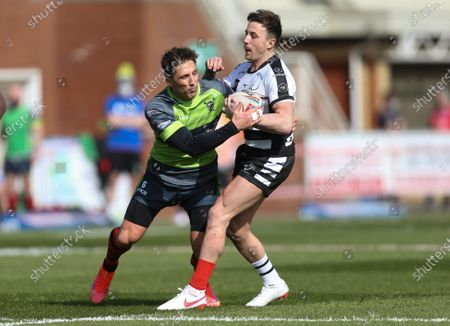 Gavin Henson of West Wales Raiders tackles Danny Craven of Widnes Vikings