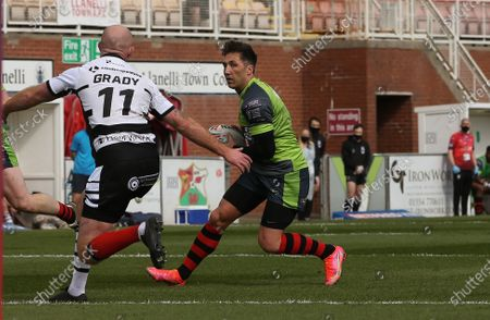 Gavin Henson of West Wales Raiders takes on Shane Grady of Widnes Vikings