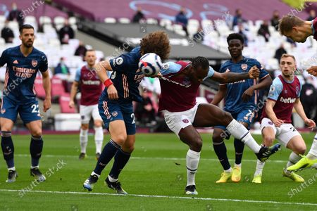 David Luiz of Arsenal FC just beats Michail Antonio of West Ham United to the cross during West Ham United vs Arsenal, Premier League Football at The London Stadium on 21st March 2021