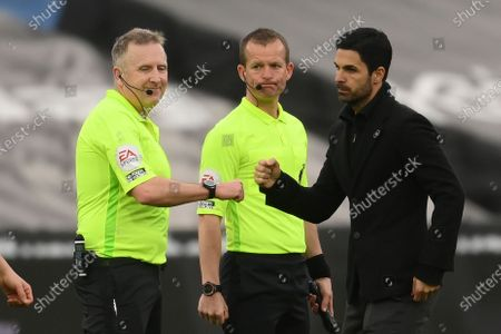 Arsenal's manager Mikel Arteta (R) and referee Jon Moss (L) react after the English Premier League soccer match between West Ham United and Arsenal FC in London, Britain, 21 March 2021.