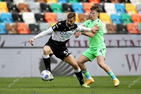Stock Picture of Udinese's Fernando Llorente (L) and Lazio's Gabarron Patric in action during the Italian Serie A soccer match between Udinese Calcio and SS Lazio in Udine, Italy, 21 March 2021.