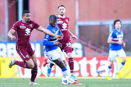 Sampdoria's Keita Balde (C) vies fot he ball with Torino's players Gleison Bremer (L) and Rolando Mandragora during the Italian Serie A soccer match between UC Sampdoria and Torino FC at Luigi Ferraris stadium in Genoa, Italy, 21 March 2021.