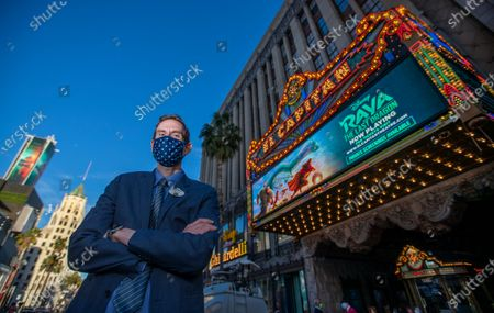"Stock Photo of James Wood, general manager for The El Capitan Theatre, poses for a photo between movies. Movie-goers were spread out with COVID-19 safety precautions in effect, watch Disney's ""Raya and the Last Dragon"" during The El Capitan Theatre's reopening after some pandemic restrictions are lifted Friday, March 19, 2021 in Hollywood, CA. The theatre was limited to 100 guests and alternating rows of seats were blocked to create forward and rear spacing of 6 feet. Physically distanced queues and physical barriers. Face coverings are required and hand sanitizers are available for guest use. (Allen J. Schaben / Los Angeles Times)"