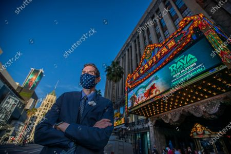 "Stock Picture of James Wood, general manager for The El Capitan Theatre, poses for a photo between movies. Movie-goers were spread out with COVID-19 safety precautions in effect, watch Disney's ""Raya and the Last Dragon"" during The El Capitan Theatre's reopening after some pandemic restrictions are lifted Friday, March 19, 2021 in Hollywood, CA. The theatre was limited to 100 guests and alternating rows of seats were blocked to create forward and rear spacing of 6 feet. Physically distanced queues and physical barriers. Face coverings are required and hand sanitizers are available for guest use. (Allen J. Schaben / Los Angeles Times)"