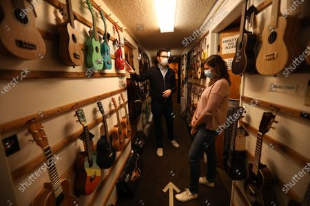 SANTA MONICA, CA McCabe's Guitar Shop 3101 Pico Blvd. Alex Minoff, left, manager at McCabe's Guitar Shop, helps customer Molly Timofte select a ukulele inside the Westside establishment in Santa Monica. McCabe's, which has been open since 1958, hasn't had a performance in their concert hall since the pandemic shut them down last March and have been unable to give in person guitar lessons. They were able to reopen the business for guitar sales and guitar repairs have been helping to make ends meet. Guitarists and singers like Richard Thompson, Mary Gauthier, Ry Cooder,, Dave Alvin, Fiona Apple, John Hammond, Tom Petty, Emmylou Harris and Adrian Belew are just a fraction of the people who have performed at McCabe's. Bob and Espie Riskin, who operated the club for five decades, retired last year due to the coronavirus pandemic. They passed on operations to their daughter and son-in-law, Nora and Walt McGraw. (Genaro Molina / Los Angeles Times)