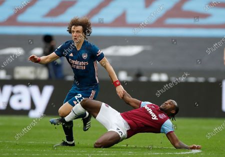 West Ham's Michail Antonio, right, challenges for the ball with Arsenal's David Luiz during the English Premier League soccer match between West Ham United and Arsenal at the London Stadium in London, England