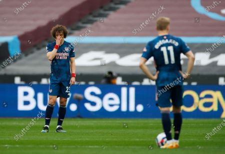 Stock Picture of Arsenal's David Luiz, left, reacts after West Ham's Jarrod Bowen scored his side's second goal during the English Premier League soccer match between West Ham United and Arsenal at the London Stadium in London, England