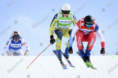 (L-R) Jean Frederic Chapuis of France, Florian Wilmsmann of Germany, and Jonas Lenherr of Switzerland in action during the men's Ski Cross event at the FIS Ski Cross, SX, World Cup Finals in Veysonnaz, Switzerland, 21 March 2021. Wilmsmann won the event.