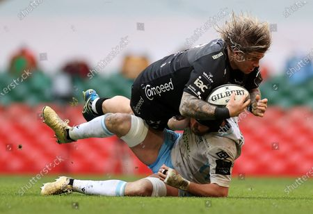 Richard Hibbard of Dragons is tackled by Ryan Wilson of Glasgow.