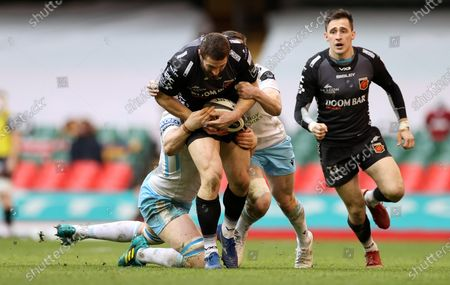 Jonah Holmes of Dragons is tackled by Ryan Wilson and Lee Jones of Glasgow.