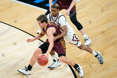 Stock Photo of Loyola of Chicago's Braden Norris, left, is defended by Illinois' Adam Miller, right, during the first half of a college basketball game in the second round of the NCAA tournament at Bankers Life Fieldhouse in Indianapolis