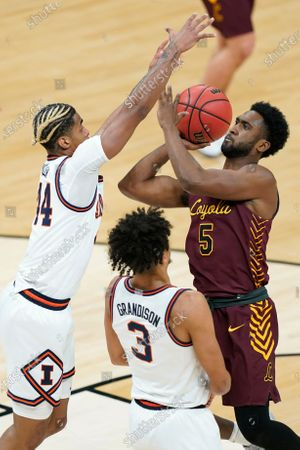 Loyola of Chicago's Keith Clemons (5) shoots against Illinois' Adam Miller (44) and Jacob Grandison (3) during the first half of a college basketball game in the second round of the NCAA tournament at Bankers Life Fieldhouse in Indianapolis